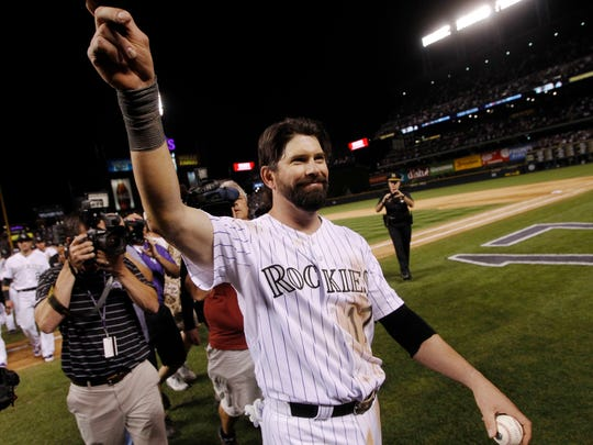 After playing his final game at home, Colorado Rockies first baseman Todd Helton acknowledges the fams after the Boston Red Sox's 15-5 victory in a baseball game in Denver on Wednesday, Sept. 25, 2013. Helton will retire at season's end after playing 17 years at first base for the Rockies. (AP Photo/David Zalubowski)