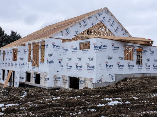 Most of the trusses were in place in late January on a house being built in St. Johns for Lane and Emily Bargeron. The couple and their 2-year-old daughter hope to move in by August.