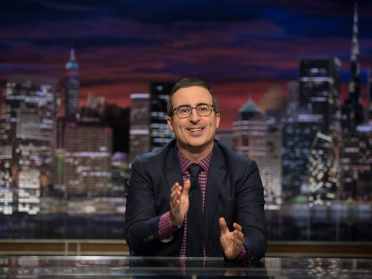John Oliver at his desk in the third-season finale