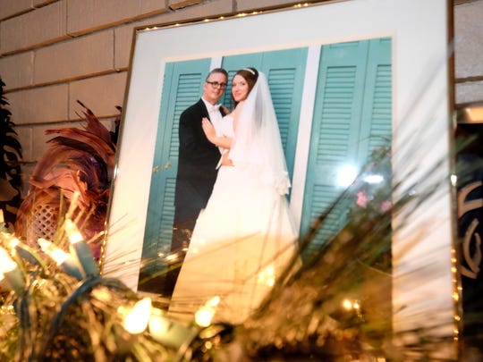 A photo of Christian and Phoebe Hopps rests on the mantle of the fireplace at their home in Kewadin, Mich.