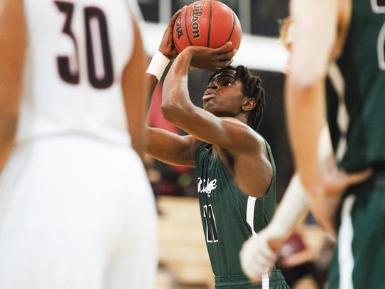 Mountain Ridge's Saikou Gueye (11) shoots a free throw