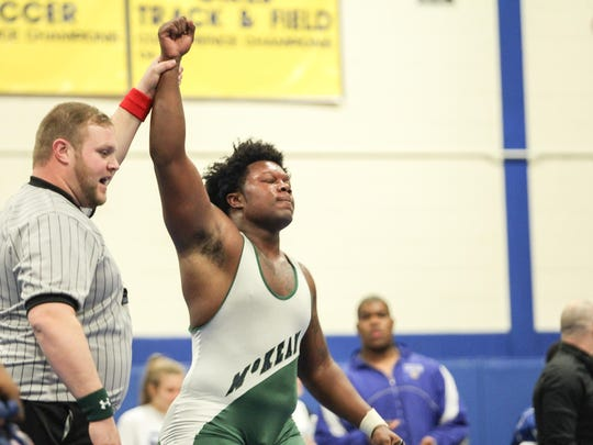 Loma Thomas of McKean celebrates his finals over Jay-Juan Jones of A.I duPont  during an 285-pound finals match in the Blue Hen Conference wrestling tournament Saturday, Feb. 18, 2017, at A.I. duPont High School in Wilmington.