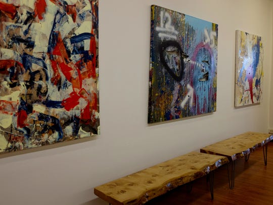 Works by Chuck Hosier along a wall of the new Pitman Gallery and Art Center.