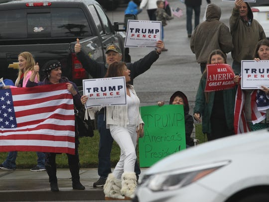 Supporters of President Donald Trump hold a rally March