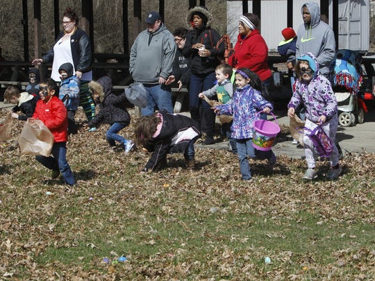 Dozens of kids race into the field behind the Moose Family Center to hunt for Easter eggs. The event was part of the second annual Autism Awareness Fundraiser