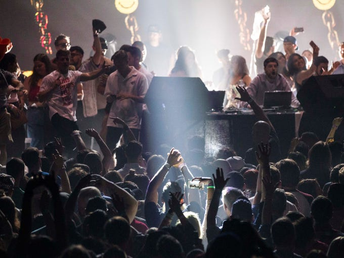 Fans cheer as Girl Talk performs at Comerica Theatre
