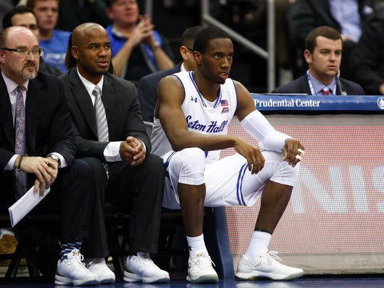 Fred Hill (far left) and Shaheen Holloway (center) won't be on Seton Hall's coaching staff next season.