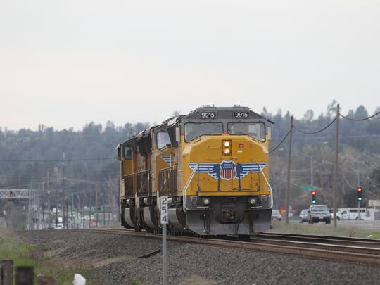 A train sits stopped on the tracks just off Highway 273 in south Redding after hitting and killing a boy Wednesday morning.