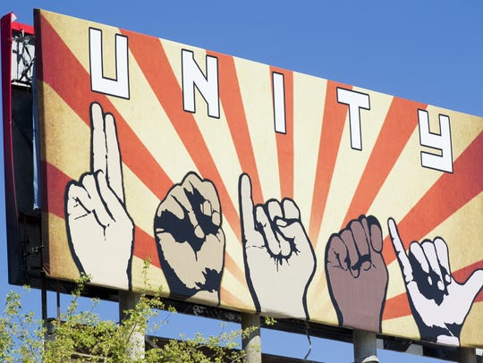 """A billboard depicting the word """"unity"""" spelled out"""
