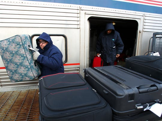 February 26, 2015 - Brian Rodgers, with Amtrak, unloads luggage for the passengers disembarking the City of New Orleans train from Chicago in Memphis early Thursday morning.