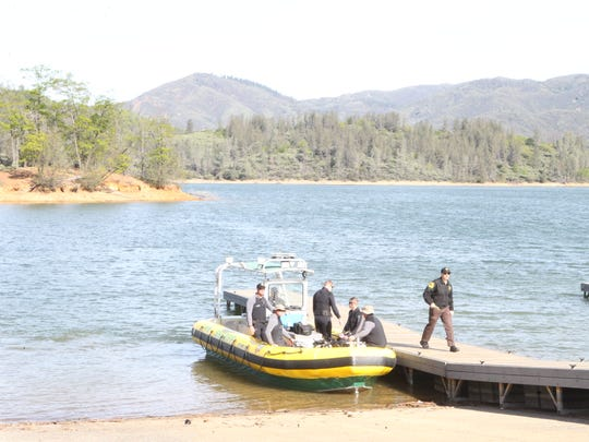 A number of law enforcement officers were at Whiskeytown Lake on Saturday to resume searching for the body of Bridget Jacobs. Divers found more human remains believed to be from the missing woman.