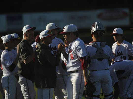 Chiles' Garrett Mathes is congratulated by teammates after wrapping up three perfect innings in a 9-6 win over Leon.
