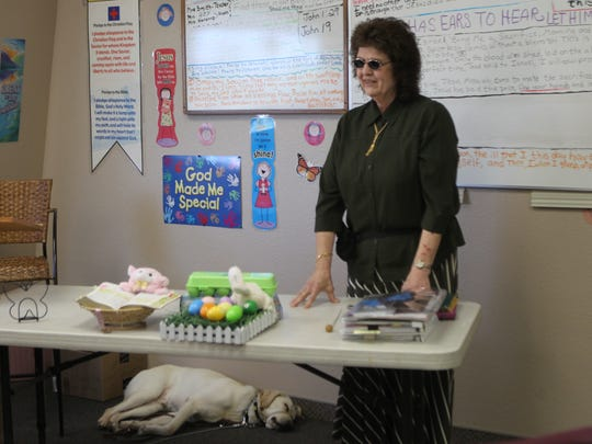 Becky Smith teaches Bible study at Shasta Baptist Church. Wilbur often naps in the back during lessons.