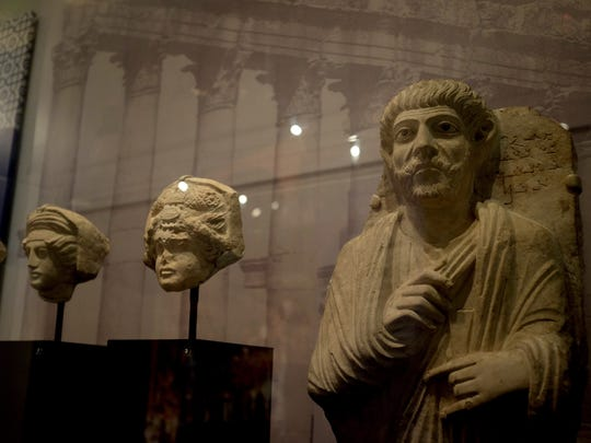 Busts and other cultural artifacts from the Penn Museum collection are displayed to show the culture archaeologists are fighting to preserve.