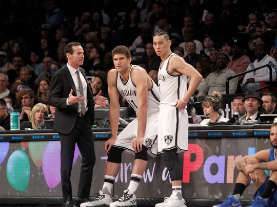 Brooklyn Nets head coach Kenny Atkinson with center