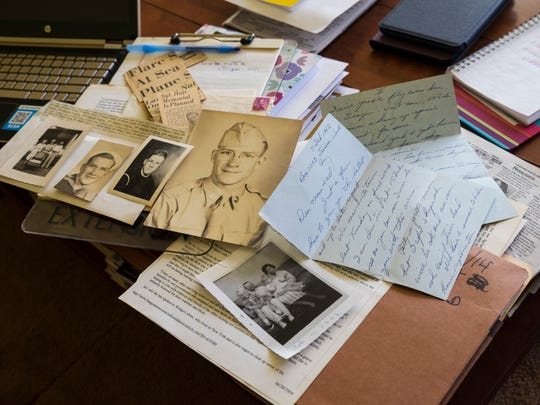The last letter from Melvin Lewis Hatt, dated 11 Feb. 1962, sits among photos and newspaper clippings in Donna Ellis' home in Haslett May 12. The plane carrying Melvin Lewis Hatt, an Army ranger, went down while flying from Guam to Vietnam.