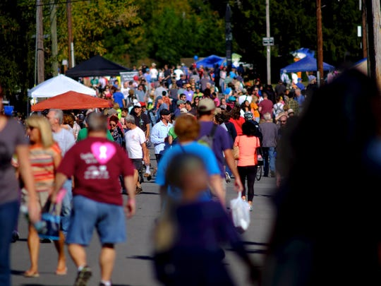 Hundreds gather along Homberg Drive during Open Streets Knoxville on Oct. 9, 2016. Open Streets Knoxville, hosted by Bike Walk Knoxville, fell along Sutherland Avenue, Mohican Street and Homberg Drive, with a variety of shopping vendors, food vendors, exercising opportunities, arts and crafts, games for the kids and a place to socialize.
