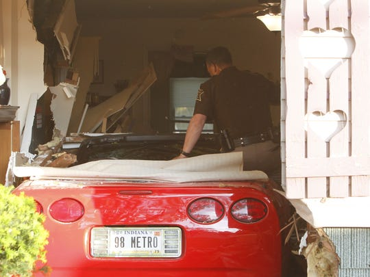 No one was seriously injured when this Corvette drove into a house in Buck Creek. Tippecanoe County sheriff's deputies are investigating.