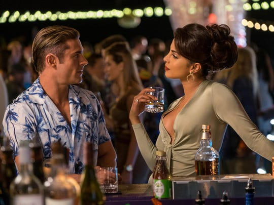 "This image released by Paramount Pictures shows Zac Efron as Matt Brody, left, and Priyanka Chopra as Victoria Leeds in ""Baywatch."" (Frank Masi/Paramount Pictures via AP)"