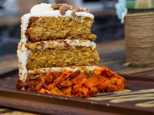 The house carrot cake is a favorite at Liberty Township restaurant Cozy's Pub Friday, May 26, 2017.