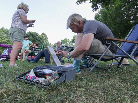 Matt Sipe paints while waiting for a evening concert during Bellevue State Park 40th celebration Sunday, July 02, 2017, at Bellevue State Park in Wilmington.