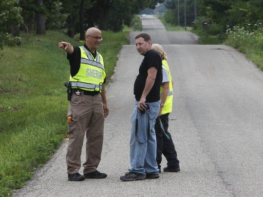Investigators documents the scene Thursday, July 13,