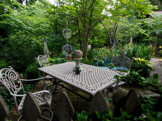 The whimsical garden at the home of Margie and Bill Ellis Tuesday, July 11, 2017 in Georgetown.