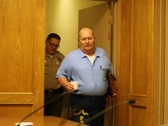 Michael Jerome Hayes enters a parole hearing room Thursday