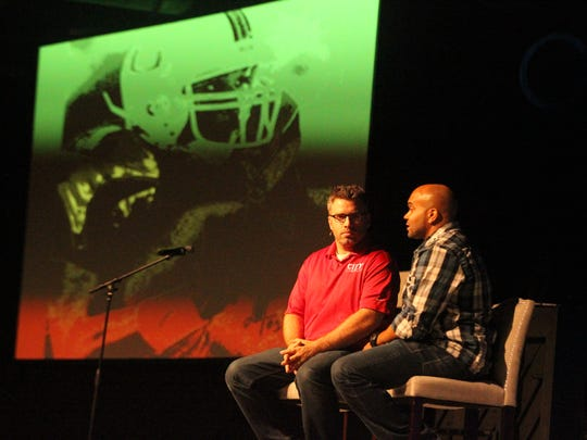 Former Miami Hurricanes receiver Daryl Jones, who won a 2001 national title, speaks with City Church pastor Dean Inserra during the 4th annual Team Tallahassee kick-off dinner on Friday night at City Church.