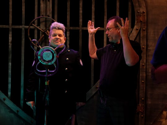 Joel Hodgson, right, works with Patton Oswalt behind