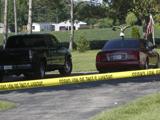 Two cars were parked outside of Donita and Patrick Elliott's house Tuesday morning while police investigate Donita Elliott's death.