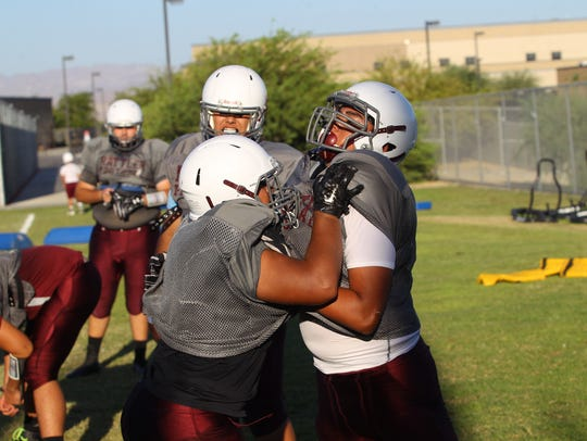 Rancho Mirage High School football players practice