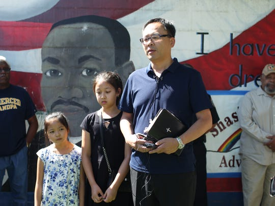 Pastor Sung Kim of Cornerstone Community Church in Redding, stands with his two daughters, and talks about the Charlottesville attack.