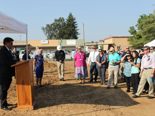 Dean Germano, chief executive officer of Shasta Community Health Center, talks to the crowd about the new location's expanded services in this file photo.