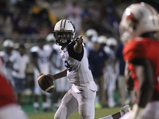 Gadsden County quarterback Dentarrius Yon points as