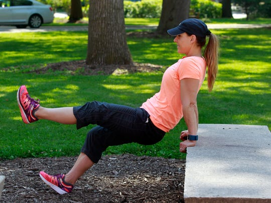 Catherine Andersen,co-owner and personal trainer at Adventure Boot Camp in Milwaukee, demonstrates the triceps dips exercise from the dorm and campus workout series.
