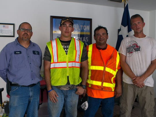 The 'Fulton Boys,' (L-R) Johnny Davis, Ernesto Garza, Rudy Robles and Matt Olenick, raced against Hurricane Harvey to lead Fulton residents to safety during the eye of the storm.