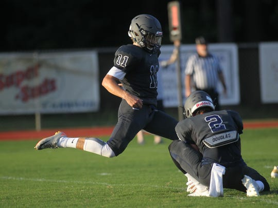 Maclay's Jack Brady tries to kick an extra point.