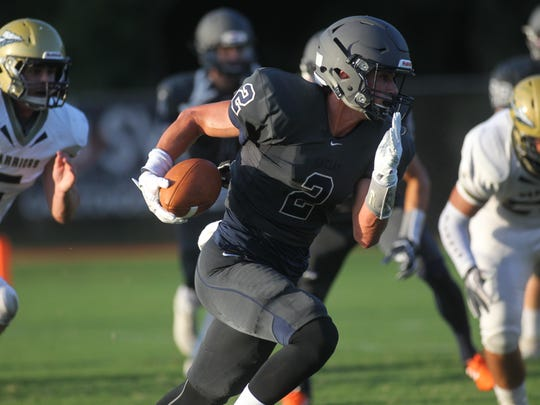 Maclay's John Sniffen heads around right edge for a
