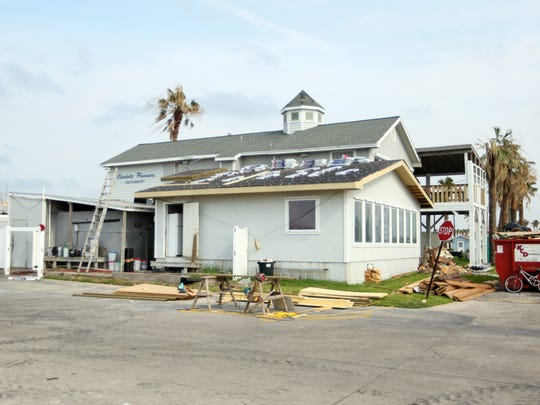 Roofers were busy Wednesday, Sept. 6, 2017, at Charlotte Plummer's Seafood at Fulton Harbor.