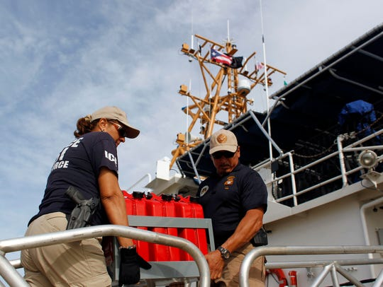 Crew members loading gas to send to St. Thomas, one