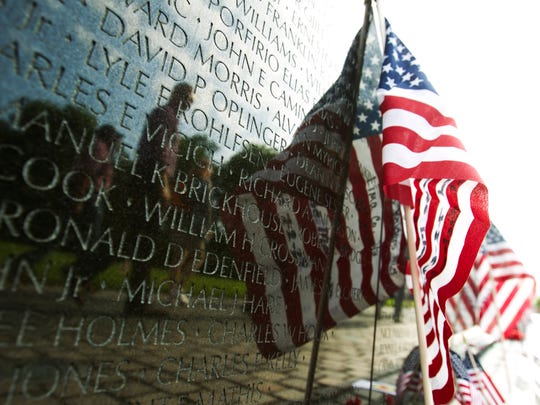 A U.S. flag adorns the wall of the Vietnam Veterans Memorial in Washington DC, May 28, 2017.