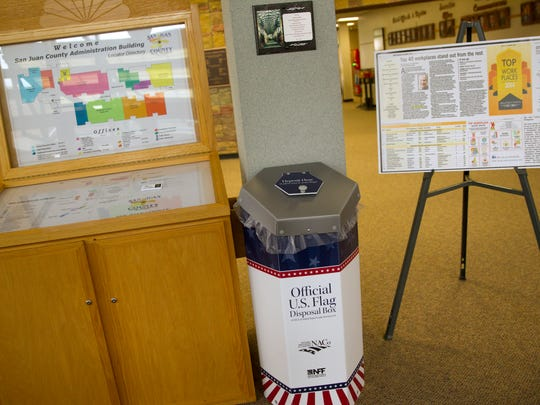 A flag disposal unit is located inside the San Juan County Government building, Thursday, Sept. 15, 2017 in Aztec. San Juan County is providing places for people to drop off their old flags for retirement.