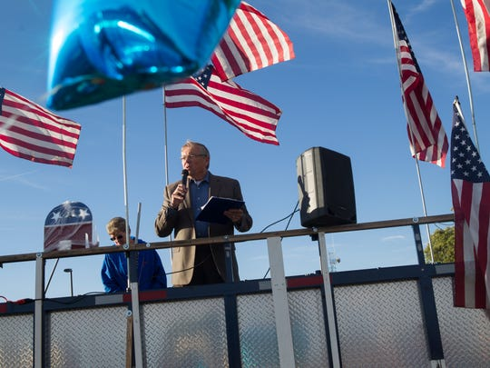 State Sen. Bill Sharer, R-Farmington, speaks during the Stop Catch and Release Rally Tuesday in Aztec.