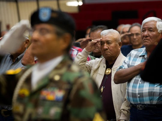 Vietnam veterans salute during the presentation of colors Thursday at a Vietnam veterans pinning ceremony at Navajo Technical University in Crownpoint.
