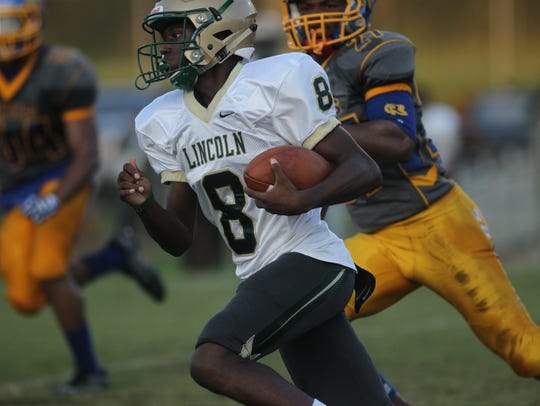 Lincoln quarterback Chris Beard escapes the pocket