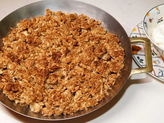 Warm apple and dried cherry crisp with whipped cream