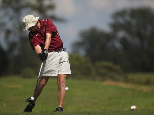 Chiles senior Bryce Johnson hits a drive on the first