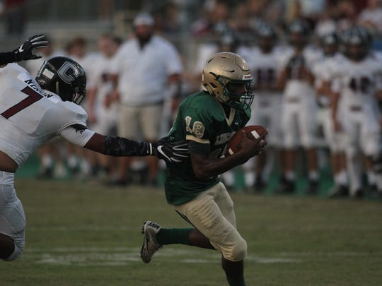 Lincoln running back John Bailey gets outside past a Chiles defender to score a first-quarter touchdown.