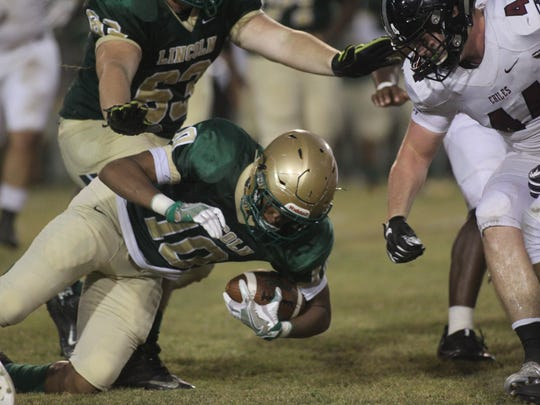 Lincoln receiver Stan Johnson is tackled after a reception.